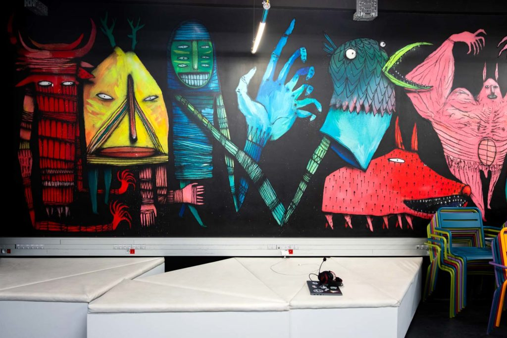 Large street art work with coloured robots and animals.